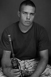 Lcpl. Jason Zorzi, 20, Sacramento, California. Headquarters Platoon, Kilo Company, 3rd Battalion, 1st Marine Regiment, 1st Marine Division, United States Marine Corps, at the company's firm base in Hit, Iraq on Friday Sept. 23, 2005.