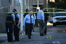 July 30, 2017 - Chicago, IL, USA - Police investigate the scene where a woman was shot and killed, her 4-year-old son was shot in the arm and a 19-year-old man was also shot near Lockwood and Kamerling in the Austin neighborhood on Friday, July 28, 2017. (Credit Image: © E. Jason Wambsgans/TNS via ZUMA Wire)