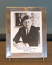 Embargoed to 0001 Friday July 21<br /> a framed photograph of President John F Kennedy by Alfred Eisenstaedt, inscribed 'To Her Majesty The Queen II, with the highest esteem, John F Kennedy' presented during a dinner at Buckingham Palace in 1961 on the display of gifts presented to Queen Elizabeth II throughout her 65 year reign on show during a preview for the Royal Gifts exhibition, which is part of the annual Summer Opening of the State Rooms at Buckingham Palace, London.