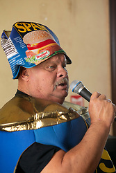 """""""Spam King"""" Paul Steele runs the show at the 22nd annual Spam Festival, Sunday, Feb. 16, 2019, in Isleton, Calif. Spam lovers competed for prizes by presenting their favorite Spam-infused foods, or entering the Spam-eating and Spam-toss contests. (Photo by D. Ross Cameron)"""