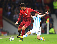 Javier Pastore of Argentina tackles Andre Gomes of Portugal - Argentina vs. Portugal - International Friendly - Old Trafford - Manchester - 18/11/2014 Pic Philip Oldham/Sportimage