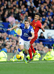 Everton's Seamus Coleman passes Liverpool's Philippe Coutinho - Photo mandatory by-line: Dougie Allward/JMP - Tel: Mobile: 07966 386802 23/11/2013 - SPORT - Football - Liverpool - Merseyside derby - Goodison Park - Everton v Liverpool - Barclays Premier League