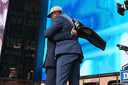 April 26, 2018 - Arlington, TX, U.S. - ARLINGTON, TX - APRIL 26:  Marcus Davenport hugs NFL Commissioner Roger Goodell  on stage after being chosen by the New Orleans Saints with the fourteenth pick during the first round at the 2018 NFL Draft at AT&T Statium on April 26, 2018 at AT&T Stadium in Arlington Texas.  (Photo by Rich Graessle/Icon Sportswire) (Credit Image: © Rich Graessle/Icon SMI via ZUMA Press)