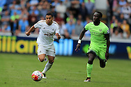 Jefferson Montero of Swansea city (l) breaks past Bacary Sagna of Manchester city . Barclays Premier league match, Swansea city v Manchester city at the Liberty Stadium in Swansea, South Wales on Sunday 15th May 2016.<br /> pic by Andrew Orchard, Andrew Orchard sports photography.