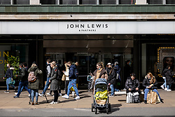 © Licensed to London News Pictures. 12/04/2021. London, UK. Shoppers outside John Lewis on Oxford Street after the department store reopened. Pubs, restaurants and non-essential shops reopened on Monday 12 April 2021 as England begins the second phase of 'unlocking' after months of lockdown. Photo credit: Rob Pinney/LNP
