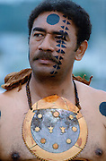 Fijian warrior withhis face painted in the traditional manner and wearing a breastplate while attending a tribal gathering in Fiji, South Pacific