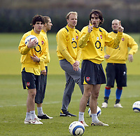 Photo: Chris Ratcliffe.<br /> Arsenal Training Session. UEFA Champions League. 18/04/2006.<br /> Robert Pires points upwards as Cesc Fabregas looks on during training
