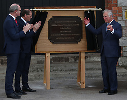 The Prince of Wales (right) unveils a plaque during a visit to the Naval Base, near Cork as part of his tour of the Republic of Ireland.