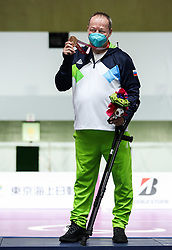 TOKYO, JAPAN - SEPTEMBER 01: Bronze medalist Francek Gorazd Tirsek - Nani of Slovenia celebrates at Victory ceremony after  the R5 - Mixed 10m Air Rifle Prone SH3 Final on day 8 of the Tokyo 2020 Paralympic Games at Asaka Shooting Range on September 01, 2021 in Asaka, Japan.  Photo by Vid Ponikvar / Sportida