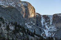 The last light of the day shines on the granite wall which is part of Spear Peak in the Bighorn Mountains.