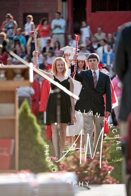 Class Marshals Rosalie Philpot and Joshua Bennett escort the Laconia High School Class of 2009 onto the athletic field for Friday's Commencement Exercises.  (Alan MacRae/for the Citizen)