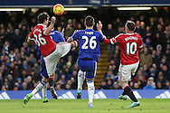 John Terry, the Chelsea captain is intercepted by Matteo Darmian of Manchester United and Wayne Rooney, the Manchester United captain. Barclays Premier league match, Chelsea v Manchester Utd at Stamford Bridge in London on Sunday 7th February 2016.<br /> pic by John Patrick Fletcher, Andrew Orchard sports photography.
