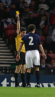 Photo: Andrew Unwin.<br />Scotland v USA. International Challenge. 12/11/2005.<br />The referee, Alberto Undiano Mallenco (L), shows Scotland's Christian Dailly (R), the yellow card for his foul on DaMarcus Beasley.