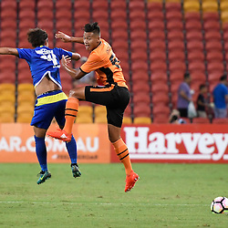 BRISBANE, AUSTRALIA - JANUARY 31: Dane Ingham of the roar and Hikaru Minegishi of Global FC compete for the ball during the second qualifying round of the Asian Champions League match between the Brisbane Roar and Global FC at Suncorp Stadium on January 31, 2017 in Brisbane, Australia. (Photo by Patrick Kearney/Brisbane Roar)