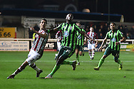 Ade Azeez of AFC Wimbledon and Craig Woodman of Exeter City chase down the looping ball during the Sky Bet League 2 match between Exeter City and AFC Wimbledon at St James' Park, Exeter, England on 28 December 2015. Photo by Stuart Butcher.
