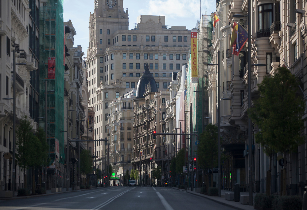 MADRID, SPAIN - APRIL 14, 2020: Gran Vía, one of Madrid's most transited streets, completely deserted on April 14, 2020.  More than 15,000 people are reported to have died in Spain due to the COVID-19 outbreak, although the country has reported a decline in the daily number of deaths. (Photo by Miguel Pereira/Getty Images)