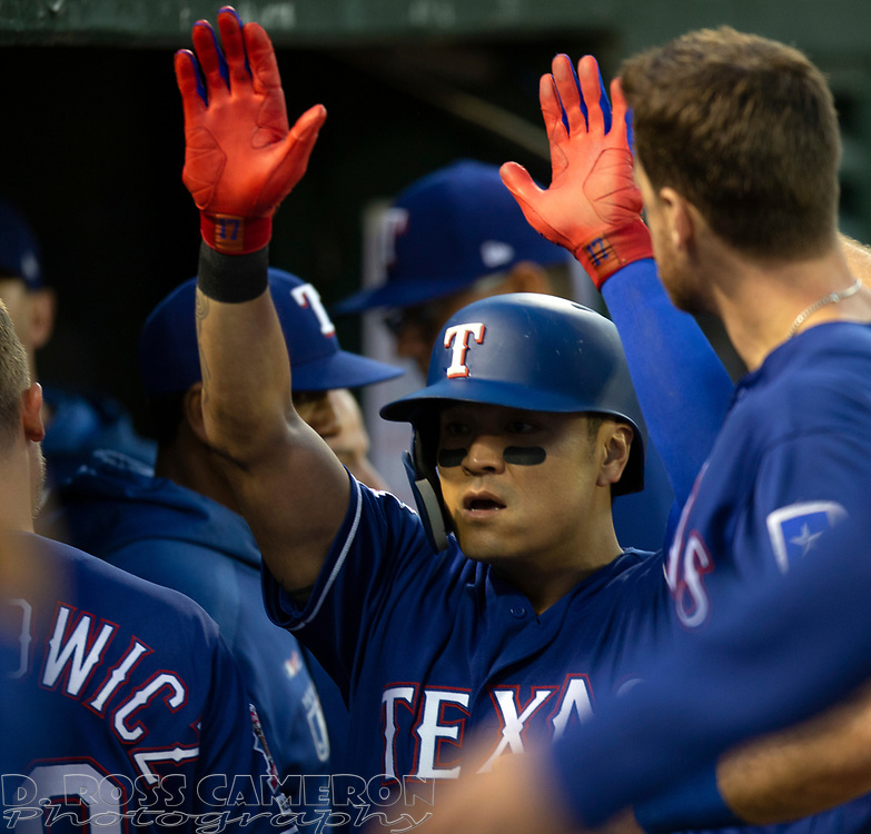 Jul 25, 2019; Oakland, CA, USA; Texas Rangers Shin-Soo Choo gets high fives from his teammates after scoring during the fifth inning of a baseball game against the Oakland Athletics at Oakland Coliseum. Mandatory Credit: D. Ross Cameron-USA TODAY Sports
