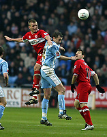 Photo: Chris Ratcliffe.<br />Coventry City v Middlesbrough. The FA Cup. 28/01/2006.<br />Lee Cattermole (L) of Boro climbs above Don Hutchinson.