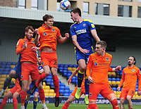 Football - 2020 /2021 Sky Bet League One - AFC Wimbledon vs Portsmouth - Plough Lane<br /> <br /> Ben Heneghan of Wimbledon  jumps above the Portsmouth defence<br /> <br /> Credit : COLORSPORT/ANDREW COWIE