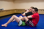 DALLAS, TX - MARCH 14:  Ryan Benoit (right) warms up backstage before fighting Sergio Pettis during UFC 185 at the American Airlines Center on March 14, 2015 in Dallas, Texas. (Photo by Cooper Neill/Zuffa LLC/Zuffa LLC via Getty Images) *** Local Caption *** Ryan Benoit