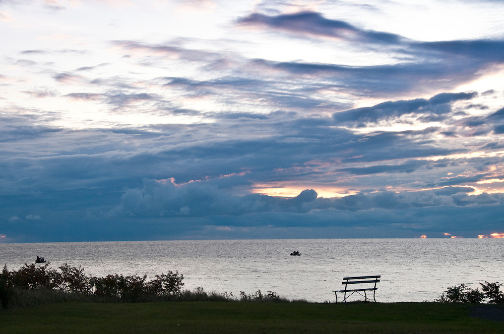 Bench overlooking Lake Michigan at dusk at Fayette State Historical Park near Garden Michigan.