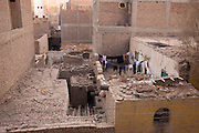 An aerial view of drying washing amidt rubble and dusty rooftops of houses in the village of Bairat, on the West Bank of Luxor, Nile Valley, Egypt.