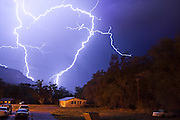 A dramatic lightning storm strikes down in the mountains above Jemez Springs, New Mexico on July 9, 2006. The Summer monsoons bring to the Jemez some of the highest rates of lightning strikes in the country, second only to Florida.