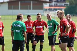 14.07.2013, Walchsee, AUT, FC Augsburg, Trainingslager, im Bild Markus WEINZIERL (Trainer FC Augsburg) mit den Neulingen Arif EKIN (FC Augsburg #31, re. v. Trainer) und Tim RIEDER, Tobias ZELLNER (Co-Trainer FC Augsburg) // during a trainings session of German 1st Bundesliga club FC Augsburg at their training camp in Walchsee, Austria on 2013/07/14. EXPA Pictures © 2013, PhotoCredit: EXPA/ Eibner/ Klaus Rainer Krieger<br /> <br /> ***** ATTENTION - OUT OF GER *****