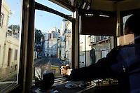 03 JAN 2006, LISBON/PORTUGAL:<br /> Waehrend einer Fahrt mit einer der fast historischen Strassenbahnen durch die alten Stadtteile der Stadt Lissabon<br /> During a ride with the old streetcars through the  historical districts of the city of Lisbon<br /> IMAGE: 20060103-01-004<br /> KEYWORDS: Lisboa, Reise, travel, Europa, europe, Strassenbahn, Straßenbahn, Fahrer, driver, Nahverkehr, Bahn, streetcar, tram, tramline