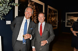 Left to right, CHARLES DELEVINGNE and VISCOUNT LINLEY at the Christie's Conservation Lectures in aid of Tusk held atChristie's, 8 King Street, London on 30th April 2014.
