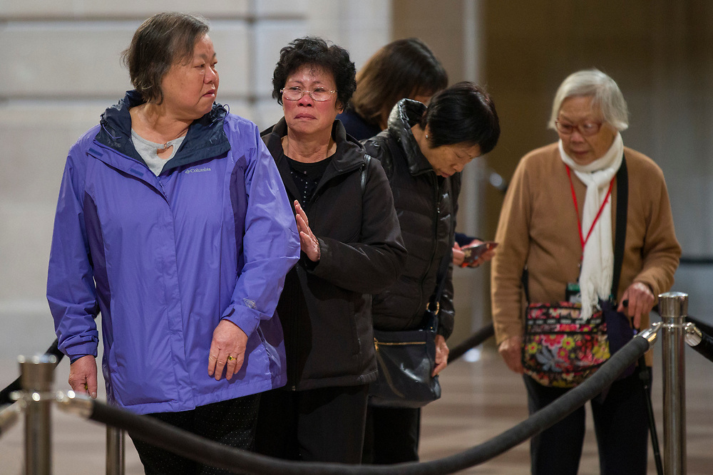 People pay their respect to San Francisco Mayor Ed Lee as he lies in state at City Hall on Friday, Dec. 15, 2017, in San Francisco, Calif. Lee died on Tuesday from a heart attack. He was 65 years old.