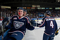 KELOWNA, CANADA - JANUARY 3: Connor Bouchard #19 of the Tri-City Americans sits on the boards and celebrates a goal against the Kelowna Rockets on January 3, 2017 at Prospera Place in Kelowna, British Columbia, Canada.  (Photo by Marissa Baecker/Shoot the Breeze)  *** Local Caption ***