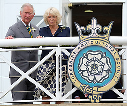 © Licensed to London News Pictures.14/07/15<br /> Harrogate, UK. <br /> <br /> HRH The Prince of Wales and the Duchess of Cornwall wave to gathered crowds during their visit on the opening day of the Great Yorkshire Show.  <br /> <br /> England's premier agricultural show opened it's gates today for the start of three days of showcasing the best in British farming and the countryside.<br /> <br /> The event, which attracts over 130,000 visitors each year displays the cream of the country's livestock and offers numerous displays and events giving the chance for visitors to see many different countryside activities.<br /> <br /> Photo credit : Ian Forsyth/LNP