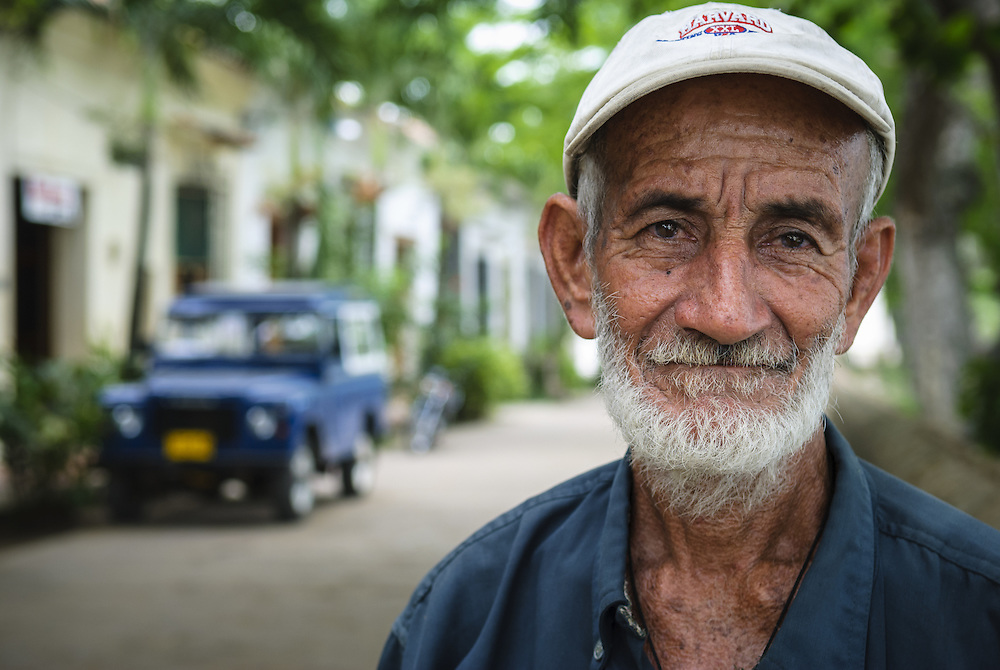 I no longer remember the name of the gentleman in this photo. I do, however, remember that we met on the street my first day in Mompos, a sleepy town on the Magdalena River. He said hello, and when he asked how long I would be visiting, I conveyed as best I could in my few words of Spanish that I would be here for three days.<br /> <br /> On the third day our paths crossed again. Recalling that my departure was near, he looked me in the eye, placed his right hand on my shoulder, and then prayed a blessing for my onward journey. <br /> <br /> I spent maybe three minutes of my life with this kind man. But it was long enough to feel seen and cared for. It was long enough to be blessed. It was long enough that even now, seven years later, I feel his touch.