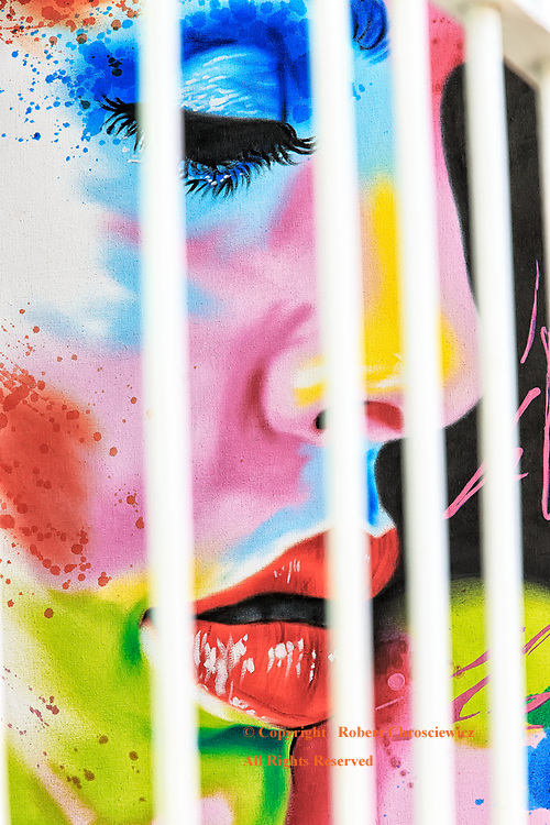 Imprisoned: The bars of an art gallery imprison this ladies portrait, mirroring the individuals experience in the communist community, Trinidad Cuba.