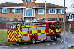 © Licensed to London News Pictures. 08/02/2020. Milton Keynes, UK. A fire engine from the Buckinghamshire Fire and Rescue Service makes its way into the Kents Hill Park Training and Conference Centre. A Milton Keynes conference centre is to house evacuees from the Chinese city of Wuhan, the epicentre of the Novel Coronavirus (2019-nCoV) outbreak, the British citizens are due to be flown back on Sunday 9th February and are expected to land at RAF Brize Norton in Oxfordshire and will remain at the conference centre for 14 days to be monitored. Photo credit: Peter Manning/LNP