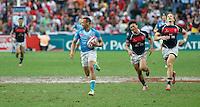 HONG KONG, HONG KONG : Dan Norton of England runs away for the score against Hong Kong, in England's  42-7 win in the Bowl Final, at the Hong Kong Rugby Sevens, shown in Hong Kong on Sunday, 24 March, 2013.