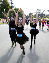 A trio of ballerinas pirouette through Golden Gate Park at the 107th running of the Bay to Breakers, Sunday, May 20, 2018, in San Francisco. (Photo by D. Ross Cameron)