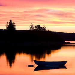 A skiff at sunrise in Eggemoggin Reach in Little Deer Isle, Maine.