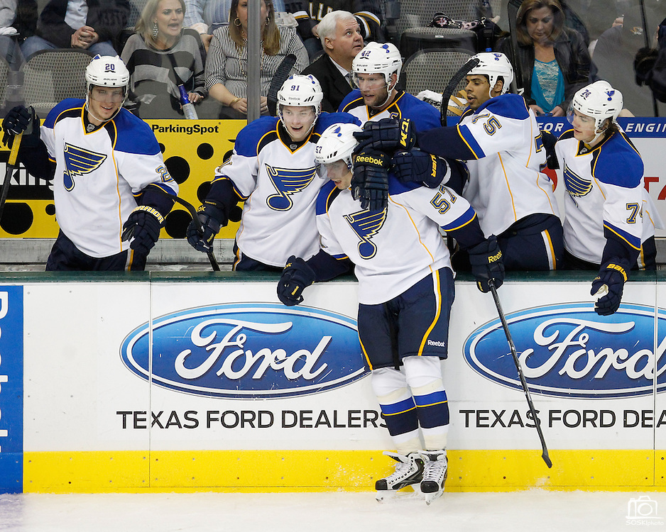 St. Louis Blues left wing David Perron (57) is embraced by his teammates after scoring a goal in the second period against the Dallas Stars at the American Airlines Center in Dallas, Texas, on January 26, 2013.  (Stan Olszewski/The Dallas Morning News)