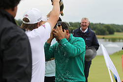 29.06.2014, Golf Club Gut Laerchenhof, Pulheim, GER, BMW International Golf Open, im Bild Winner der BMW international Open 2014 Fabrizio Zanotti (PAR) mit Champangerdusche // during the International BMW Golf Open at the Golf Club Gut Laerchenhof in Pulheim, Germany on 2014/06/29. EXPA Pictures © 2014, PhotoCredit: EXPA/ Eibner-Pressefoto/ Kolbert<br /> <br /> *****ATTENTION - OUT of GER*****