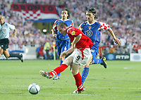 England v Croatia - Estadio de Luz, Lisbon - 21st June 2004<br />England's Wayne Rooney scores the third goal in front of Croatia's Niko Kovac<br />Photo: Jed Leicester/Sporting Pictures<br />© Sporting Pictures (UK) Ltd<br />www.sportingpictures.com<br />Tel: +44 (0)20 7405 4500<br />Fax: +44 (0)20 7831 7991