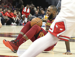 October 24, 2017 - Cleveland, OH, USA - The Cleveland Cavaliers' LeBron James grimaces after an apparent ankle injury during the second quarter against the Chicago Bulls on Tuesday, Oct. 24, 2017, at Quicken Loans Arena in Cleveland. (Credit Image: © Phil Masturzo/TNS via ZUMA Wire)