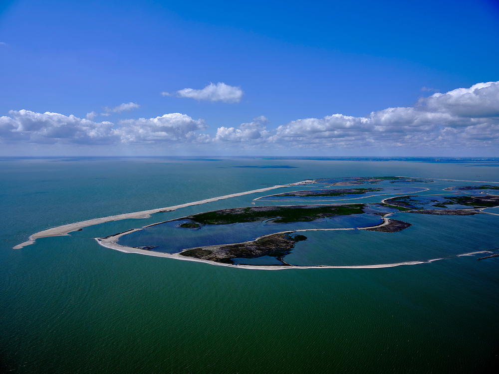 Nederland, Flevoland, Markermeer, 07-05-2021; Marker Wadden in het Markermeer. Gezien vanuit het Zuiden.<br /> Doel van het project van Natuurmonumenten en Rijkswaterstaat is natuurherstel, met name verbetering van de ecologie in het gebied, in het bijzonder de kwaliteit van bodem en water. De Marker Wadden archipel bestaat momenteel uit vijf eilanden, twee nieuwe eilanden zijn in ontwikkeling.<br /> Marker Wadden, artifial islands. The aim of the project is to restore the ecology in the area, in particular the quality of soil and water.<br /> The Marker Wadden archipelago currently consists of five islands, two new islands are under development.<br /> luchtfoto (toeslag op standard tarieven);<br /> aerial photo (additional fee required)<br /> copyright © 2021 foto/photo Siebe Swart