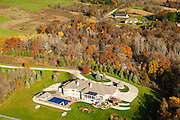 Aeriial photograph of a large, rural home with a swimming pool in Wisconsin on a beautiful autumn day.