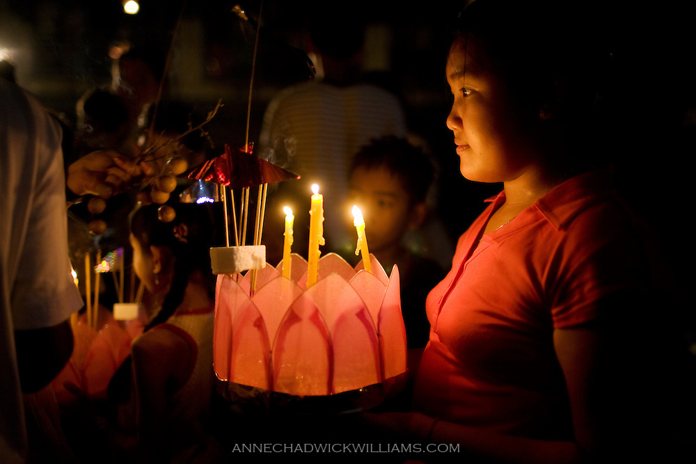 A girl waits to float her lantern on the river in Siem Reap, Cambodia during the annual International Water Festival.