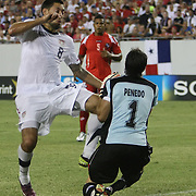USA midfielder Clint Dempsey (8) collides with Panama goalkeeper Jaime Penedo (1)during a  CONCACAF Gold Cup soccer match between the United States and Panama on Saturday, June 11, 2011, at Raymond James Stadium in Tampa, Fla. (AP Photo/Alex Menendez)