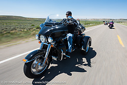Larry Mann ofAurora, CO on his 2015 Tri Glide riding from Steamboat Springs, Colorado, to Baggs, Wyoming during the Rocky Mountain Regional HOG Rally, USA. Friday June 9, 2017. Photography ©2017 Michael Lichter.