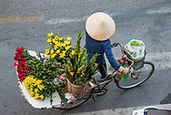 Flower vendor in the old quarter of Hanoi, Vietnam.