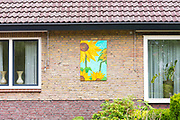 OTTERLO, NETHERLANDS: Residents display Vincent Van Gogh posters at home by Kroller Muller museum, during traditional festival, Otterlo, Netherlands